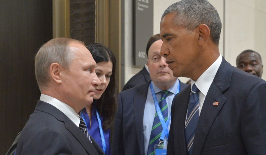 Russian President Vladimir Putin speaks with President Obama in Hangzhou, China, on Sept. 5, 2016 in this file photo. (Associated Press) **FILE**