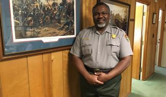In this Tuesday, Dec. 20, 2016, Petersburg National Battlefield Superintendent Lewis Rogers poses at the park's headquarters in Petersburg, Va. The national park in Virginia could expand by more than 7,000 acres under legislation Congress recently passed. (AP Photo/Sarah Rankin)