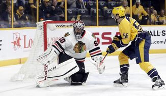 Chicago Blackhawks goalie Corey Crawford (50) blocks a shot by Nashville Predators left wing Kevin Fiala (56), of Switzerland, during the second period of an NHL hockey game Thursday, Dec. 29, 2016, in Nashville, Tenn. (AP Photo/Mark Humphrey)