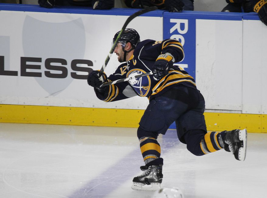 Buffalo Sabres forward Brian Gionta (12) breaks his stick during the second period of an NHL hockey game against the Boston Bruins, Thursday, Dec. 29, 2016, in Buffalo, N.Y. (AP Photo/Jeffrey T. Barnes)