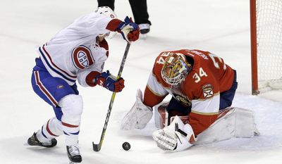 Florida Panthers goalie James Reimer (34) stops a shot by Montreal Canadiens left wing Daniel Carr, left, during the first period of an NHL hockey game, Thursday, Dec. 29, 2016, in Sunrise, Fla. (AP Photo/Alan Diaz)
