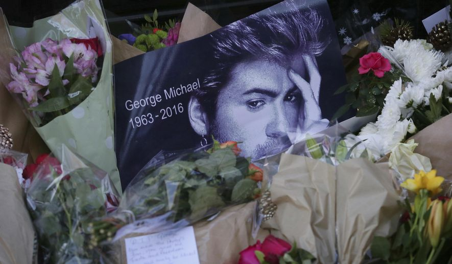 FILE - This Monday, Dec. 26, 2016 file photo shows tributes left outside the home of British musician George Michael in London. Michael, who rocketed to stardom with WHAM! and went on to enjoy a long and celebrated solo career lined with controversies, has died, his publicist said Sunday. He was 53. With the loss of several icons of Generation X's youth, the year 2016 has left the generation born between the early 1960s and the early 1980s, wallowing in memories and contemplating its own mortality. (AP Photo/Tim Ireland)