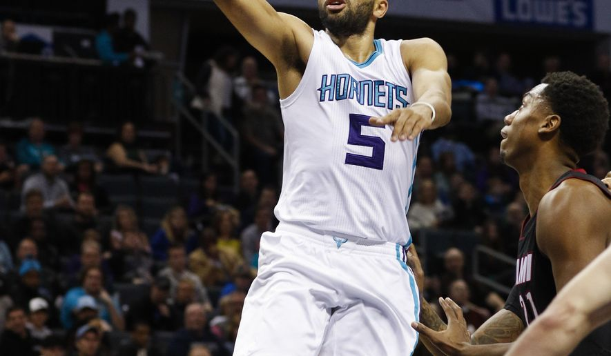 Charlotte Hornets guard Nicolas Batum, of France, drives to the basket against the Miami Heat during the first half of an NBA basketball game in Charlotte, N.C., Thursday, Dec. 29, 2016. (AP Photo/Nell Redmond)