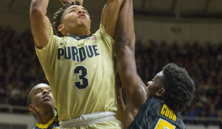 Purdue guard Carsen Edwards (3) puts up a shot over Iowa forward Tyler Cook (5) in the second half of an NCAA college basketball game in West Lafayette, Ind., Wednesday, Dec. 28, 2016. Purdue won 89-67. (AP Photo/Doug McSchooler)