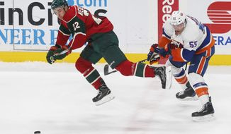 Minnesota Wild's Nino Niederreiter, left, of Switzerland, gets tripped up by New York Islanders' Johnny Boychuk during the first period of an NHL hockey game Thursday, Dec. 29, 2016, in St. Paul, Minn. (AP Photo/Jim Mone)