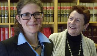 In this Dec. 19, 2016, Jane Levy, left, who has been appointed to replace a retiring judge in the Family Court division, poses in Albuquerque, N.M. with her mother Susan Conway, who also served as a judge in the Second Judicial District. (Greg Sorber/The Albuquerque Journal via AP)