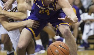 Lipscomb's Garrison Mathews, right, reaches for a loose ball in front of Missouri's Cullen VanLeer, left, during the second half of an NCAA college basketball game Thursday, Dec. 29, 2016, in Columbia, Mo. Lipscomb won 81-76. (AP Photo/L.G. Patterson)