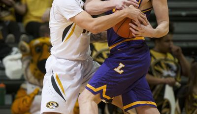 Missouri's Jordan Geist, left, tries to wrestle the ball away from Lipscomb's Garrison Mathews during the first half of an NCAA college basketball game Thursday, Dec. 29, 2016, in Columbia, Mo. (AP Photo/L.G. Patterson)