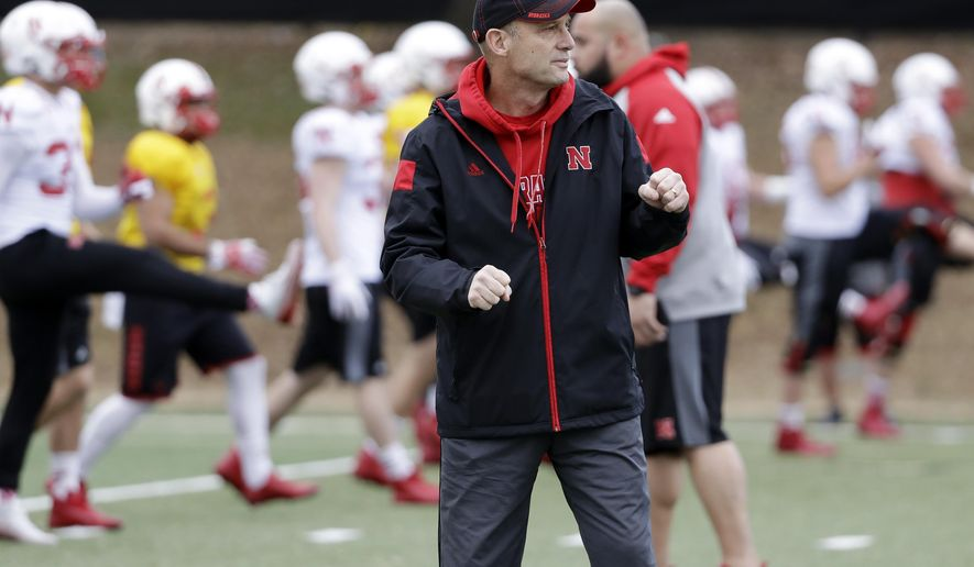 Nebraska head coach Mike Riley watches as his players warm up during practice Wednesday, Dec. 28, 2016, in Nashville, Tenn. Nebraska is scheduled to play Tennessee in the NCAA college football Music City Bowl Friday. (AP Photo/Mark Humphrey)