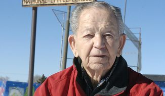 In this 2009 photo retired Gen. Franklin Miles poses in front of a welcome sign for the Franklin E. Miles Park, named in his honor, in Santa Fe, N.M. Miles, the son of a former New Mexico governor and the head of the New Mexico National Guard during the deadliest prison riot in the state's history, has died. He was 93.  (Clyde Mueller/Santa Fe New Mexican via AP)
