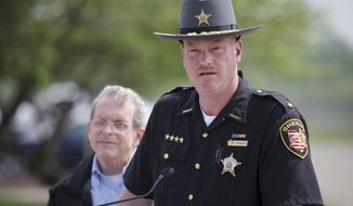 FILE - In this Wednesday, April 27, 2016, file photo, Pike County Sheriff Charles Reader speaks to the media alongside Ohio State Attorney General Mike DeWine, background, during a news conference, in Waverly, Ohio. Reader, the appointed southern Ohio sheriff investigating the slayings of eight people from one family, was sworn in Wednesday, Dec. 28, 2016, for a four-year term after winning the election. (AP Photo/John Minchillo, File)