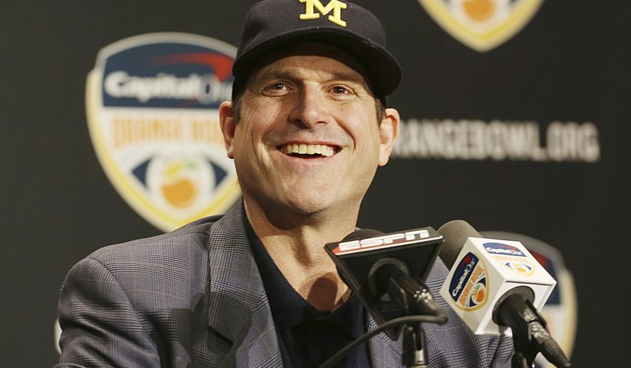 Michigan head coach Jim Harbaugh smiles during a news conference in Fort Lauderdale, Fla., Thursday, Dec. 29, 2016. Michigan plays Florida State in the Orange Bowl Friday. (AP Photo/Marta Lavandier)