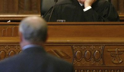 FILE - In this Nov. 29, 2005, file photo, Justice Paul Pfeifer listens to Attorney Donald Mooney present arguments in the Ohio Supreme Court in Columbus, Ohio. Pfeifer and fellow Ohio Supreme Court Justice Judith Ann Lanzinger are retiring at the end of 2016 due to mandatory age limits. (AP Photo/Will Shilling, File)