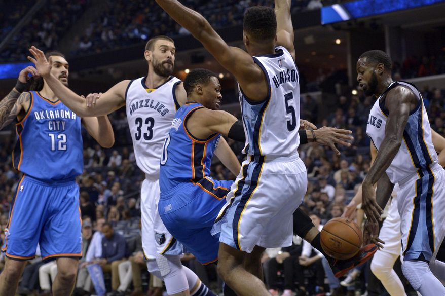 Oklahoma City Thunder guard Russell Westbrook, center, looses control of the ball while driving between Thunder center Steven Adams (12), Memphis Grizzlies center Marc Gasol (33), guard Andrew Harrison (5), and Grizzlies forward JaMychal Green, right, in the first half of an NBA basketball game Thursday, Dec. 29, 2016, in Memphis, Tenn. (AP Photo/Brandon Dill)