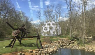 This computer illustration provided by the Crystal Bridges Museum of American Art on Dec. 28, 2016, shows a rendering of how inventor Buckminster Fuller's Fly's Eye Dome will look when installed on museum grounds in Bentonville, Ark. The museum recently told its patrons it intends to construct the futuristic dome in the summer of 2017. (Jessi Mueller/Crystal Bridges Museum of American Art via AP)