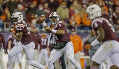 Virginia Tech's Jerod Evans (4) looks for an open receiver against Arkansas during the second half of the Belk Bowl NCAA college football game in Charlotte, N.C., Thursday, Dec. 29, 2016. Virginia Tech won 35-24. (AP Photo/Bob Leverone) **FILE**