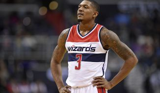Washington Wizards guard Bradley Beal (3) looks on during the first half of an NBA basketball game against the Indiana Pacers, Wednesday, Dec. 28, 2016, in Washington. (AP Photo/Nick Wass)
