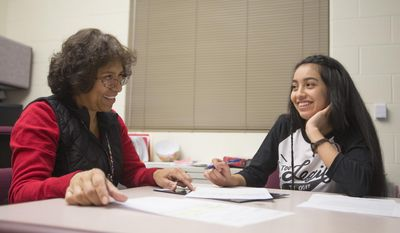 ADVANCE FOR USE FRIDAY, DEC. 30, 2016, AND THEREAFTER- In this Dec. 19, 2016, photo, Ben Lomond High mentor Nora McCroby smiles while talk to junior Evelyn Morales at Ben Lomond High School in Ogden, Utah. (Briana Scroggins/Standard-Examiner via AP)