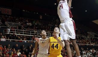 Stanford guard Marcus Sheffield (14) dunks over Arizona State guard Kodi Justice (44) during the second half of an NCAA college basketball game Friday, Dec. 30, 2016, in Stanford, Calif. Arizona State won 98-93. (AP Photo/Marcio Jose Sanchez)