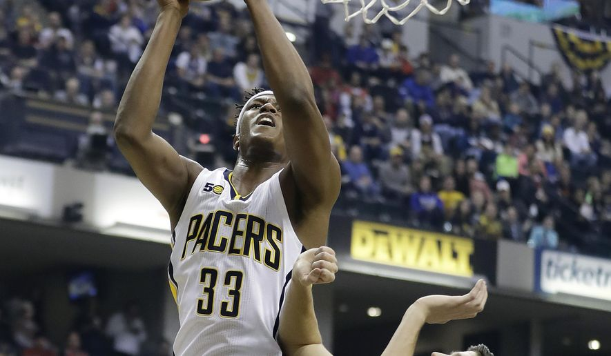 Indiana Pacers' Myles Turner shoots against Chicago Bulls' Doug McDermott, right, during the first half of an NBA basketball game Friday, Dec. 30, 2016, in Indianapolis. (AP Photo/Darron Cummings)