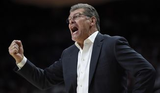 Connecticut coach Geno Auriemma calls to his team during the first half of an NCAA college basketball game against Maryland, Thursday, Dec. 29, 2016 in College Park, Md. Connecticut won 87-81. (AP Photo/Gail Burton)