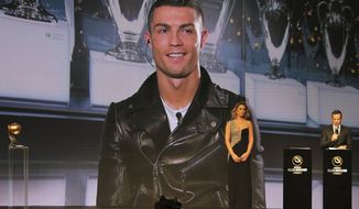 Cristiano Ronaldo speaks, via a video link live from Madrid after he was selected as the Best Player of the Year, during Dubai Football Gala & Globe Soccer Awards Ceremony in Dubai, United Arab Emirates, Tuesday, Dec. 27, 2016. (AP Photo/Kamran Jebreili)