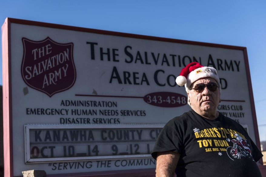 """ADVANCE FOR SATURDAY, DEC. 31, 2016 - In this undated photo Jim """"Dagger"""" Dagostine, a biker who organizes a toy drive every year to deliver to the Salvation Army, stands outside of the Salvation Army in Charleston, W.Va.  (Sam Owens/Charleston Gazette-Mail via AP)"""
