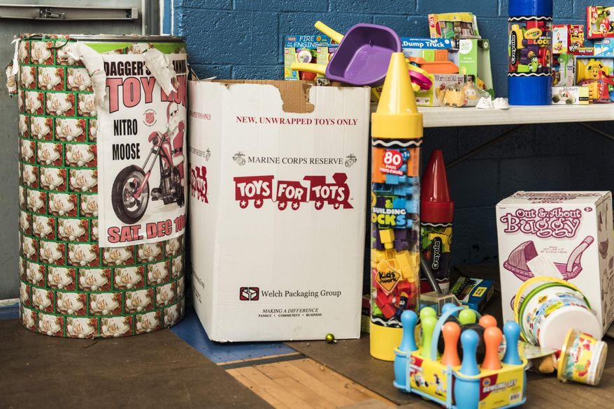"""ADVANCE FOR SATURDAY, DEC. 31, 2016 - This undated photo shows donated toys which have been collected to be given to children for Christmas at the Salvation Army in Charleston, W.Va. For the past 30 years,  Jim """"Dagger"""" Dagostine  has organized Dagger's Annual Toy Run — a toy collection drive and fundraiser to benefit the Salvation Army. (Sam Owens/Charleston Gazette-Mail via AP)"""