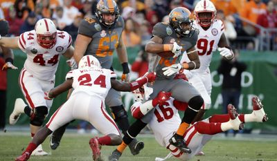 Tennessee wide receiver Jauan Jennings (15) tries to get past Nebraska defenders Aaron Williams (24) and Antonio Reed (16) in the first half of the Music City Bowl NCAA college football game Friday, Dec. 30, 2016, in Nashville, Tenn. (AP Photo/Mark Humphrey)