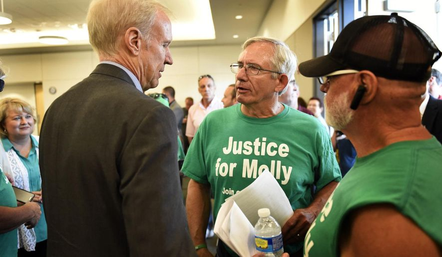 "FILE - In this July 19, 2016 file photo, Gov. Bruce Rauner, left, speaks with Larry Young, center, father of Molly Young, after Rauner signed the two bills collectively known as ""Molly's Law"" in Carbondale, Ill. The law that takes effect Jan. 1, 2017 extends the statute of limitations, from two years to five, on bringing wrongful death lawsuits and increase fines for public bodies that don't comply with court orders to release information. ""Molly's Law,"" is named after Molly Young, a Carbondale woman fatally shot in 2012 and found in her ex-boyfriend's apartment. (Byron Hetzler  /The Southern Illinoisan via AP, File)"
