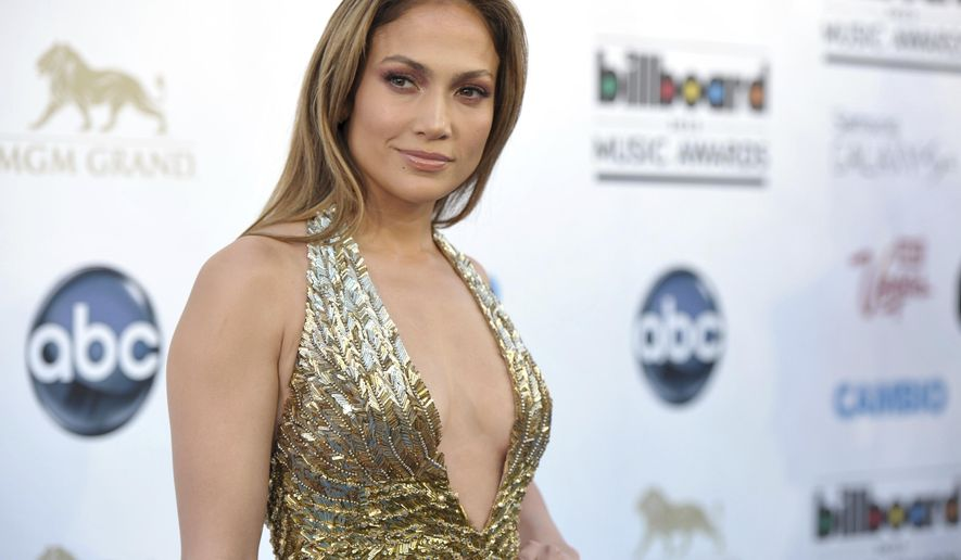 FILE - In this May 19, 2013, file photo, Jennifer Lopez arrives at the Billboard Music Awards at the MGM Grand Garden Arena in Las Vegas. Photos and videos posted online Dec. 30, 2016 of Lopez dancing with and kissing Drake has prompted internet speculation of a duet or romance between the two. (Photo by John Shearer/Invision/AP, File)