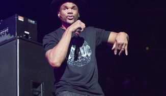 FILE - In this Dec. 9, 2014 file photo, Darryl McDaniels of Run-DMC performs at Christmas in Brooklyn in New York. The rap group Run-DMC has filed a $50 million lawsuit in New York accusing Wal-Mart, Amazon, Jet and other retailers of selling products that traded on the group's name without permission. The suit was filed in the Southern District of New York on Thursday, Dec. 29, 2016. (Photo by Scott Roth/Invision/AP, File)
