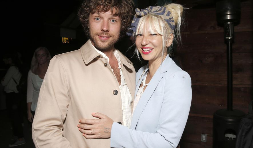 """FILE - In this Aug. 7, 2014 file photo, filmmaker Erik Anders Lang, left, and singer Sia attend a party after the premiere of """"The One I Love,"""" in Los Angeles. Court records in Los Angeles show Sia filed for divorce from her husband of two years, Lang, on Dec. 20, 2016, citing irreconcilable differences. (Photo by Todd Williamson/Invision/AP, File)"""