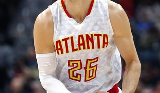Atlanta Hawks guard Kyle Korver (26) sets up a shot in the first half of an NBA basketball game against the Detroit Pistons on Friday, Dec. 30, 2016, in Atlanta. (AP Photo/Todd Kirkland)