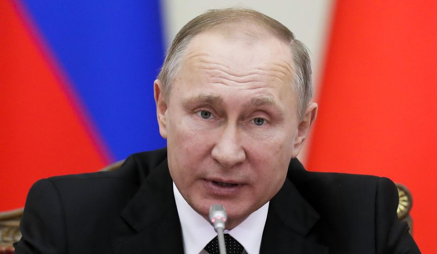 FILE _ In this Monday, Dec. 26, 2016 file photo Russian President Vladimir Putin speaks at the meeting in St.Petersburg, Russia. President Vladimir Putin said, Friday, Dec. 30, 2016 that Russia will not be expelling US diplomats in response to a new round of US sanctions. (AP Photo/Dmitri Lovetsky, File)