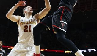 Texas Tech guard Devon Thomas, right, shoots over Iowa State guard Matt Thomas (21) during the first half of an NCAA college basketball game, Friday, Dec. 30, 2016, in Ames, Iowa. (AP Photo/Charlie Neibergall)