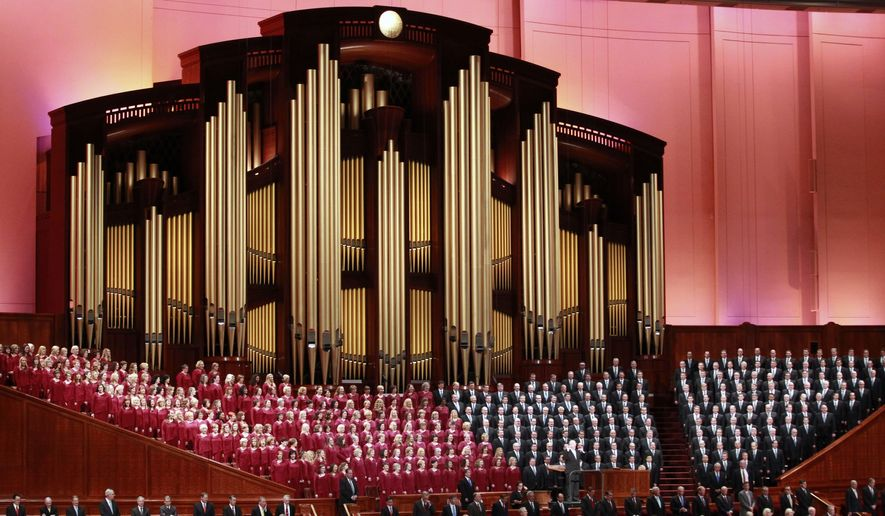 """In this Oct. 1, 2016, file photo, the Mormon Tabernacle Choir of The Church of Jesus Christ of Latter-day Saints, sings in the Conference Center at the morning session of the two-day Mormon church conference in Salt Lake City. Choir member Jan Chamberlin posted a resignation letter that she says she sent to choir leaders on her Facebook page Thursdaym Dec. 29, 2016. In it, she writes that by performing at the inaugural, the 360-member Choir will appear to be """"endorsing tyranny and facism"""" and says she feels """"betrayed"""" by the choir's decision to take part. (AP Photo/George Frey, File)"""