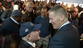 Newly announced Connecticut football head coach Randy Edsall talks with fan Milton Porter of Hebron, Conn., left, after an NCAA college football news conference at Pratt & Whitney Stadium at Rentschler Field, Friday, Dec. 30, 2016, in East Hartford, Conn. Edsall, the most successful coach in UConn football history, is returning to the Huskies to try and right the ship one more time.  (AP Photo/Jessica Hill)