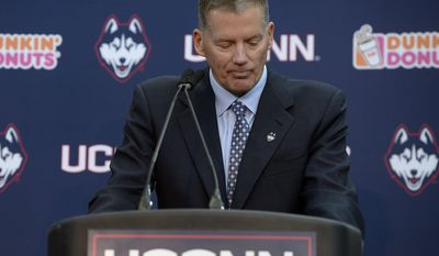 New Connecticut football head coach Randy Edsall pauses while apologizing for the way he left the UConn football program during an NCAA college football news conference at Pratt & Whitney Stadium at Rentschler Field, Friday, Dec. 30, 2016, in East Hartford, Conn. Edsall, the most successful coach in UConn football history, is returning to the Huskies to try and right the ship one more time.  (AP Photo/Jessica Hill)