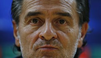 FILE - In this Tuesday, Sept. 30, 2014 file photo, Galatasaray manager Cesare Prandelli of Italy, listens to a reporter's question during a media conference before a training session at the Emirates Stadium in London, ahead of their Champions League Group D soccer match against Arsenal Wednesday. Valencia says in a statement released Friday Dec. 30, 2016, Italian manager Cesare Prandelli has resigned after three months in charge of the Spanish team. (AP Photo/Lefteris Pitarakis, File)