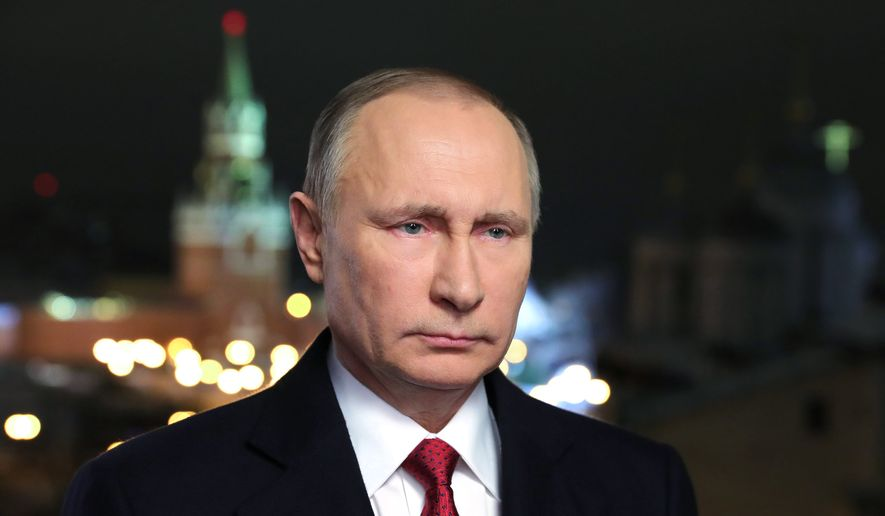 In this photo released by the Kremlin Press service via Sputnik agency, Saturday, Dec. 31, 2016, Russian President Vladimir Putin speaks during an undated recording of his annual televised New Year's message in the Kremlin in Moscow, Russia. (Mikhail Klimentyev/Kremlin Press Service, Sputnik, via AP) ** FILE **