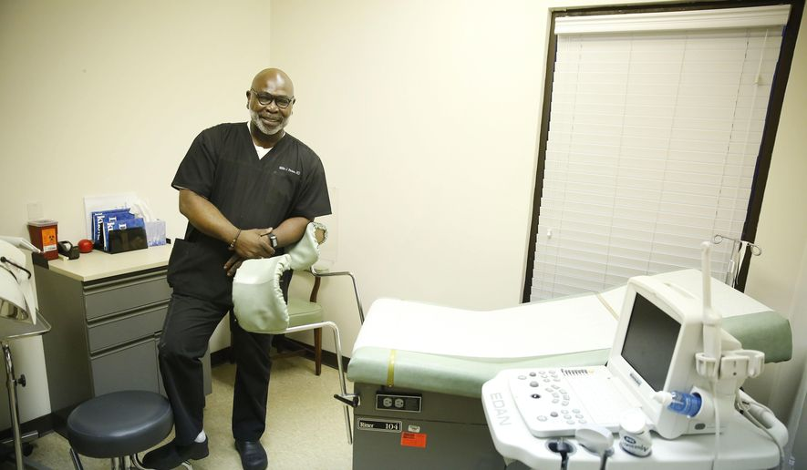 FILE - In this Feb. 22, 2016 file photo, Dr. Willie Parker stands in a procedure room for a portrait at the West Alabama Women's Center in Tuscaloosa, Ala. (AP Photo/Brynn Anderson, File)