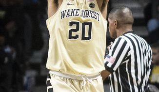 Wake Forest sophomore forward John Collins (20) holds his head in his hands in the closing minutes of Wake Forest's 73-68 loss to Clemson in an NCAA college basketball game, Saturday, Dec. 31, 2016, at the Joel Coliseum in Winston-Salem, N.C. (Andrew Dye/The Winston-Salem Journal via AP)