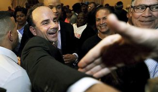 """FILE - In this Nov. 3, 2015 file photo, Democrat Joe Ganim celebrates after being elected mayor of Bridgeport, Conn., in Bridgeport. It's """"business as usual, in a positive way,"""" Ganim said a year after reclaiming the top office in Connecticut's largest city following a prison stint. (Brian A. Pounds/Hearst Connecticut Media via AP, File)"""