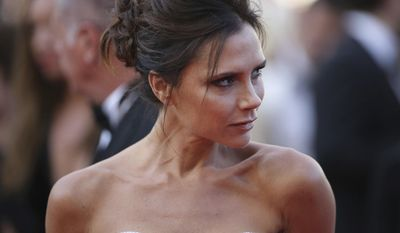 FILE - In this file photo dated Wednesday, May 11, 2016,  fashion designer Victoria Beckham arrives for the screening of the film Cafe Society at the 69th international film festival, Cannes, southern France. The former pop star Beckham, 42, is made an OBE for services to the fashion industry, in the Queen's 2017 New Year Honors list. (AP Photo/Thibault Camus, FILE)