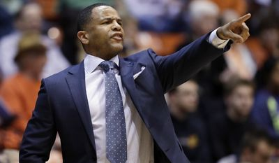 Pacific coach Damon Stoudamire directs his team during the first half of the team's NCAA college basketball game against Gonzaga on Saturday, Dec. 31, 2016, in Stockton, Calif. (AP Photo/Marcio Jose Sanchez)