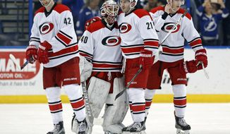 Carolina Hurricanes emergency backup goalie Jorge Alves (40) is congratulated by Joakim Nordstrom (42), of Sweden, Lee Stempniak (21), and Noah Hanifin (5) following his NHL debut in an NHL hockey game against the Tampa Bay Lightning on Saturday, Dec. 31, 2016, in Tampa, Fla. The Lightning won 3-1. (AP Photo/Mike Carlson)