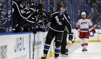 Tampa Bay Lightning's Brian Boyle celebrates his goal against the Carolina Hurricanes during the first period of an NHL hockey game Saturday, Dec. 31, 2016, in Tampa, Fla. (AP Photo/Mike Carlson)