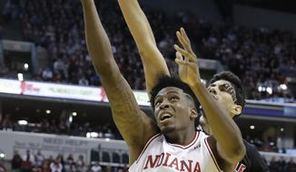 Indiana's De'Ron Davis (20) has his shot blocked by Louisville's Anas Mahmoud during the first half of an NCAA college basketball game Saturday, Dec. 31, 2016, in Indianapolis. (AP Photo/Darron Cummings)
