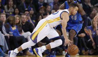 Golden State Warriors guard Stephen Curry, left, drives past Dallas Mavericks forward Harrison Barnes (40) during the first half of an NBA basketball game in Oakland, Calif., Friday, Dec. 30, 2016. (AP Photo/Tony Avelar)